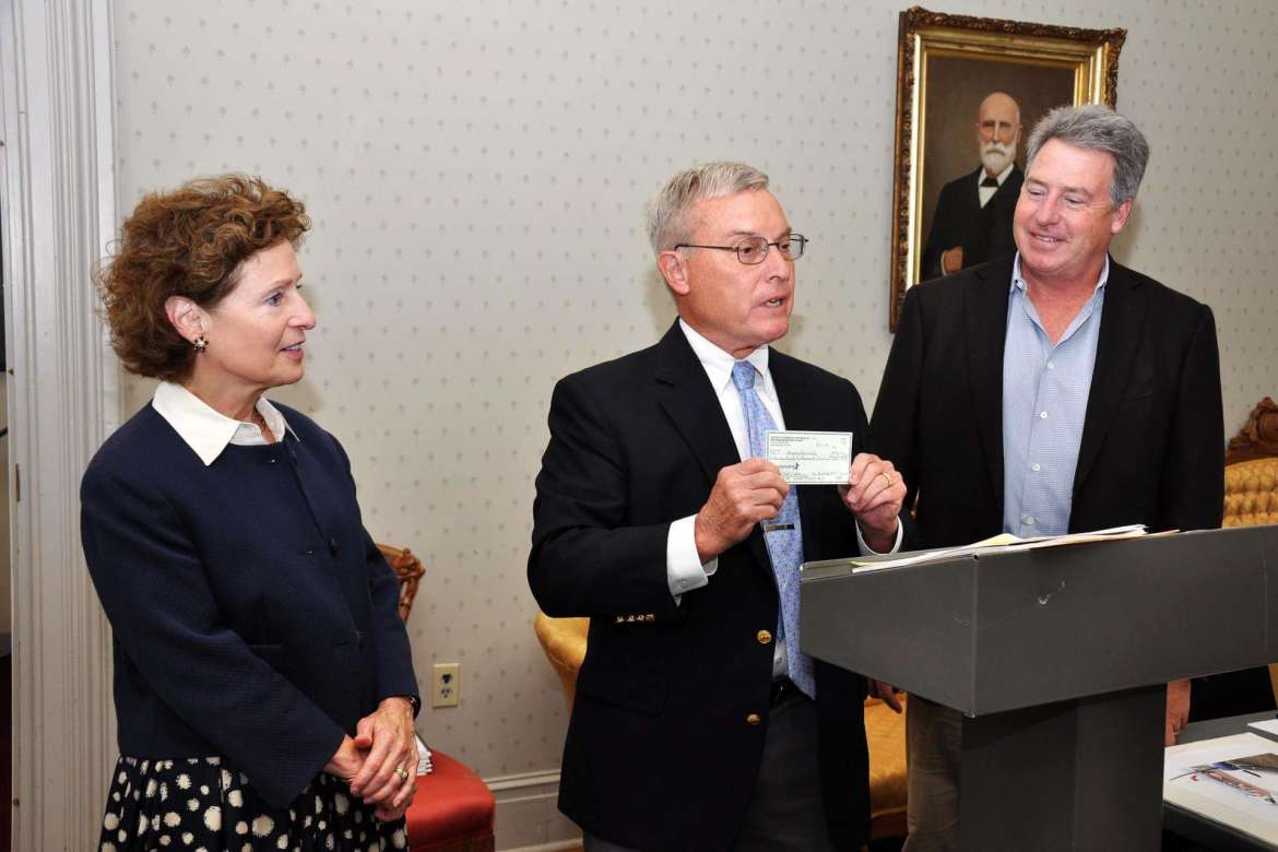 Richard McCune (center), Martinsburg attorney, presents a $222,000 check to Dr. Mary J.C. Hendrix (l.) and Mike Smith, Shepherd University Foundation president, from the estate of T. Guy Reynolds for the scholarship named in Reynolds' honor.