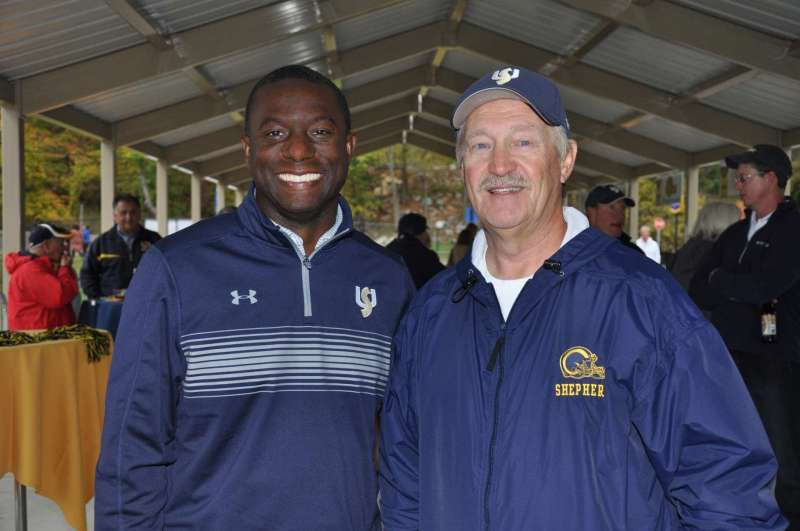 A new event, Homecoming Happy Hour, was held in the Smallwood and Small Pavilion at Ram Stadium on October 21. Alumni and friends of Shepherd had the opportunity to mingle and listen to a presentation by Coach Monte Cater. Proceeds from the event will support Shepherd athletic teams (except football). Chauncey Winbush '95 and '00 (l.), vice president for athletics, joined Coach Cater during the event.