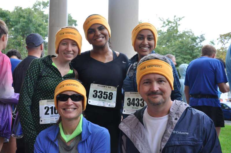 Several of Team Shepherd runners braved the rain at Freedom's Run to pose for a picture. Pictured (l. to r., front row) are Dr. Carol Plautz, Dr. Christopher Lovelace, (back row) Madelynne King, Sneha Reddy, and Jasmin Tharakan. Shepherd serves as a sponsor of the annual event.