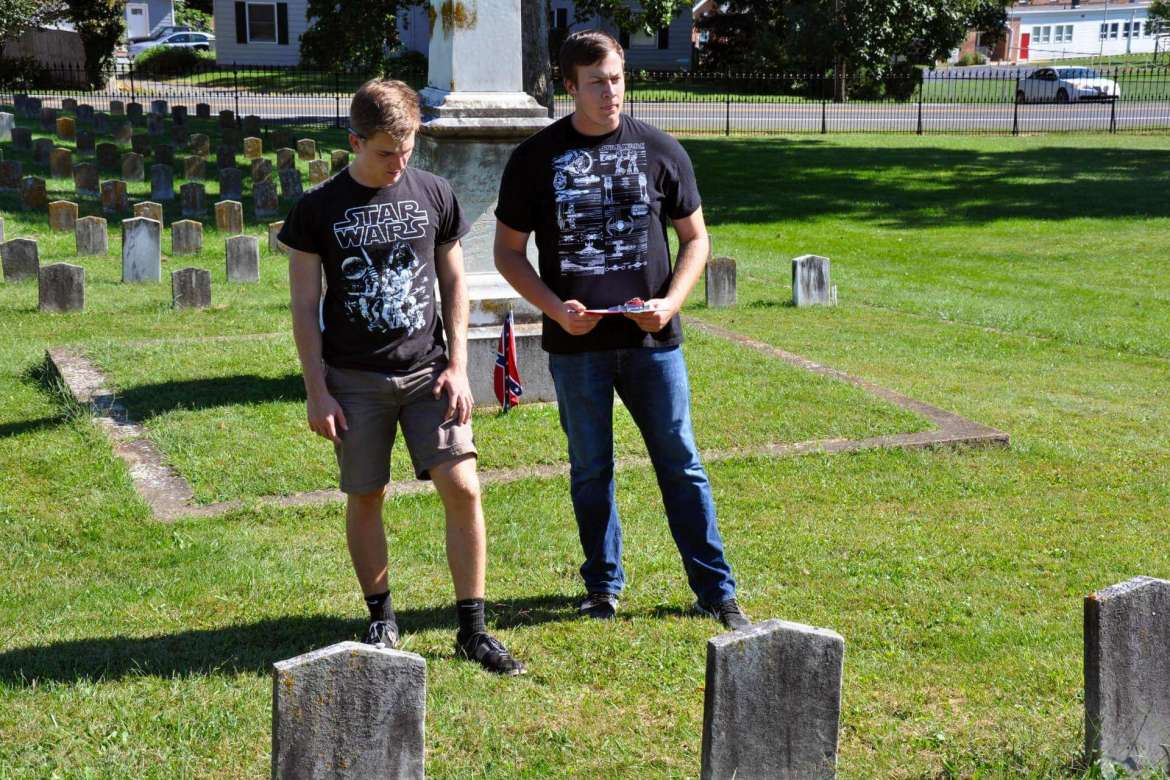 Adam Hull (left) and J.D. Wright gather information in Elmwood Cemetery.