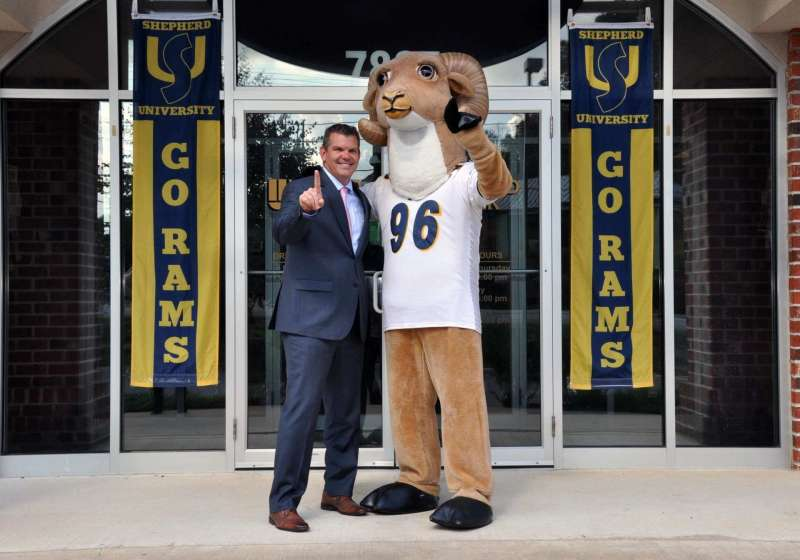 Rambo visited United Bank in Shepherdstown to thank the staff for their support of Shepherd University. Chris Colbert '95 (pictured with Rambo) is vice president for commercial lending at the bank and is a board member of the Shepherd University Foundation and past president of the Shepherd University Alumni Association. Thanks to Chris and everyone at United Bank for showing their Ram pride!