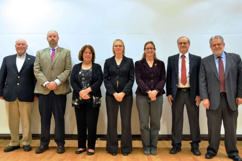Faculty presenters at the October 17 President's Lecture Series event on the Nobel Prize-winners are (l. to r.) Dr. Jim Lewin, Dr. Joe Robbins, Dr. Kathy Reid, Dr. Sytil Murphy, Dr. Carol Plautz, Dr. Dan DiLella, and Provost Chris Ames, who introduced the lecture.