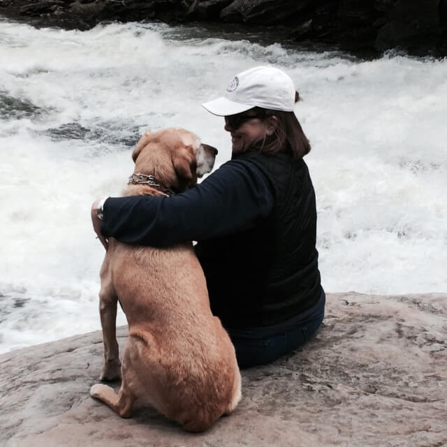 Tucker and his human Holly Frye, assistant vice president for student affairs and director of community and congressional relations
