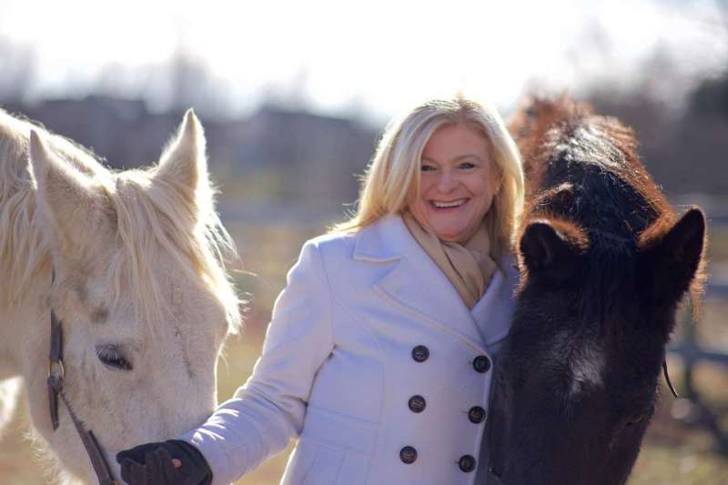 Dr. Lois Jarman, Director of the Intensive English Language Program, and her horses