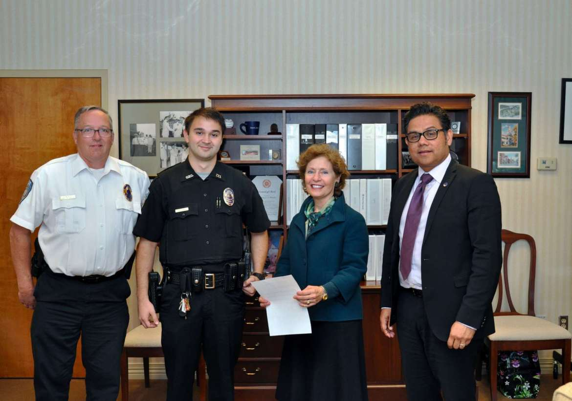Those attending the swearing in of Shepherd University's newest police officer, Zachary Ray, are (l-r) John McAvoy, chief of police; Ray; Dr. Mary J.C. Hendrix, president; and James Vigil, vice president for administration.