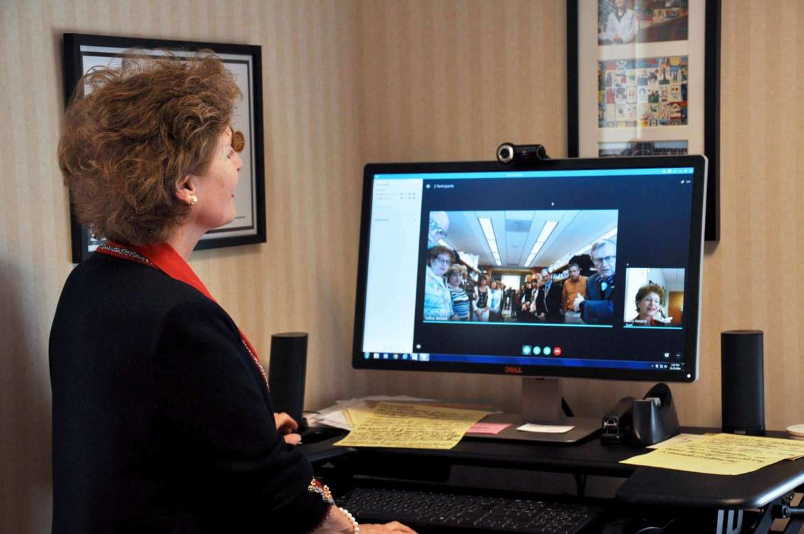 President Mary J.C. Hendrix communicate with her research team in Morgantown from her office via a live video feed.