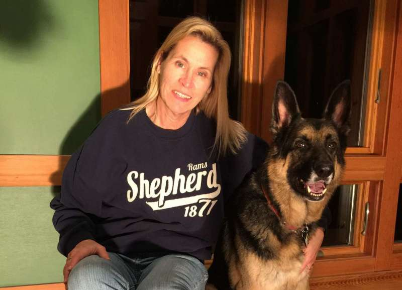 Valerie Owens ¹76 and ¹86, Executive Director of University Communications, and her German shepherd, Sabot.