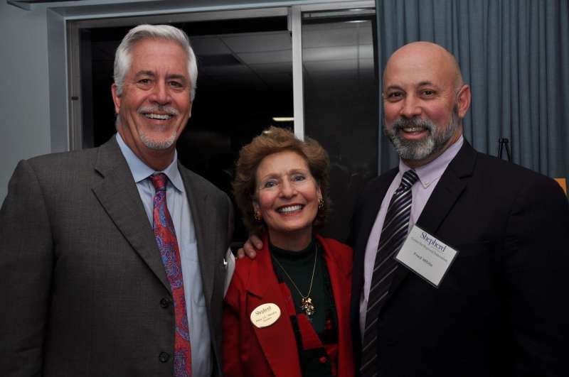 Pictured with President Mary J.C. Hendrix at the CRI event are Kurt Gehlsen (l.), vice president and scientific officer, Research Corporation Technologies, and Fred White, senior director public sector, ABS Consulting.