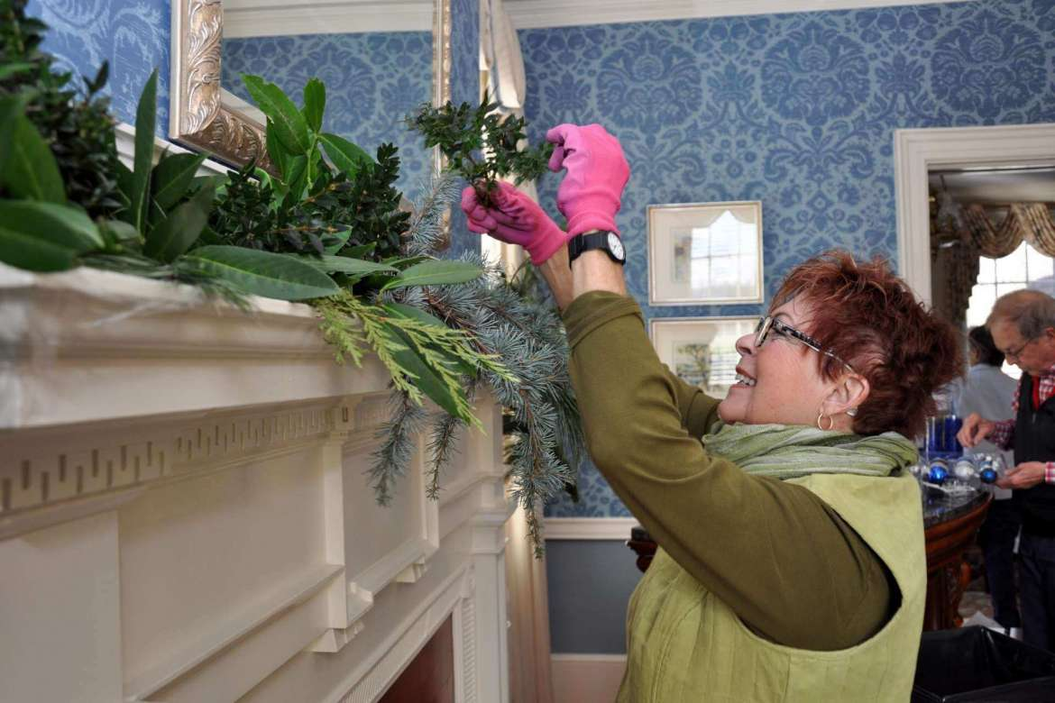 Elisabeth Staro works on decorating one of the three mantels in Popodicon.