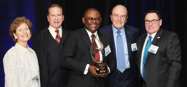 "The National Disease Research Interchange (NDRI) recently awarded its highest honor, the D. Walter Cohen Service to Science Award to Dr. Bennet I. Omalu, the doctor who first identified chronic traumatic encephalopathy (CTE) in football players and who's story is told in the 2015 feature film ""Concussion."" Pictured (l. to r.) are President Mary J.C. Hendrix, chair of NDRI; Dr. Julian Bailes, former chair of the Department of Neurosurgery at West Virginia University School of Medicine and a leader in the field of neurosurgery; Omalu; Dr. Walter Cohen, the award's namesake and former NDRI chair; and Bill Leinweber, NDRI president and CEO."
