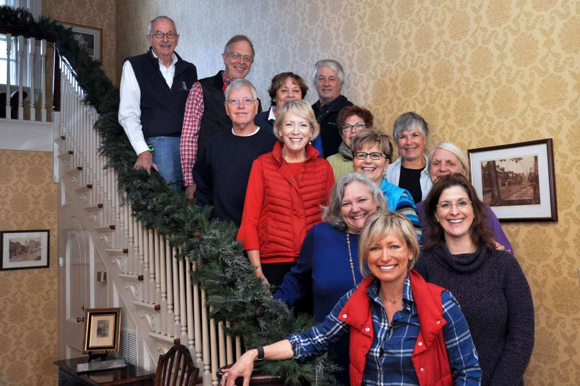 Volunteers who help decorate Popodicon for the holiday season are (front) Joy Lewis; (second row) Louise Hafer Corderman and Sonya Sholley; (third row) Connie Hoxton, Elisabeth Staro, Peachy Staley, Carol Kable, and Mary Stanley; (fourth row) Tim Valerio, Barb Gibson, and Jim Gibson; (top row) John Douglas Miller and Terry Wills.