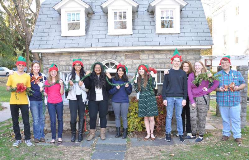 Volunteers decorating the Little House included (l. to r.) Garret O'Connell, Rachel Moreno '08, coordinator of student community service and service learning, Jillian O'Connell, Keerthana Mesineni, Shruthi, Shelby Shajimon, Courtney Glascock, Jacob Hefner, Holly Morgan Frye '09 M.A., assistant vice president for student affairs/director of community and congressional relations and advisor of Rotaract Club, Corinne Airgood, and Rickie Hensley.