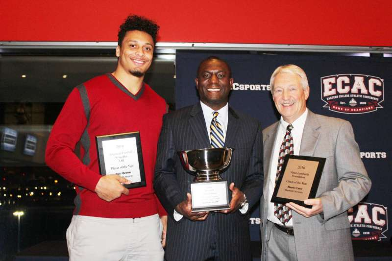 Accepting awards at MetLife Stadium during the Eastern College Football Awards Banquet were (l. to r.) Billy Brown, American Football Networks DII Player of the Year; Chauncey Winbush '95 and '00, vice president for athletics; and Monte Cater, Vince Lombardi Foundation Coach of the Year.