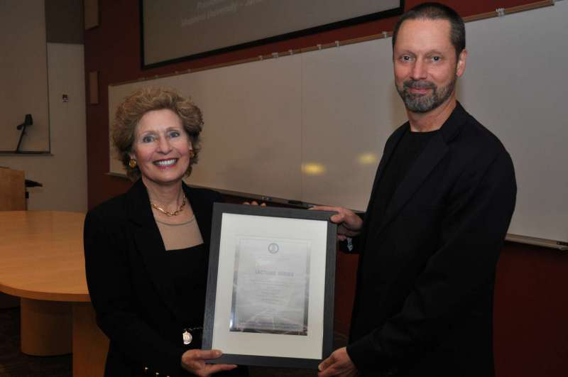 President Mary J.C. Hendrix presents a certificate of appreciation to John Amos at his lecture that was part of the President's Lecture Series.