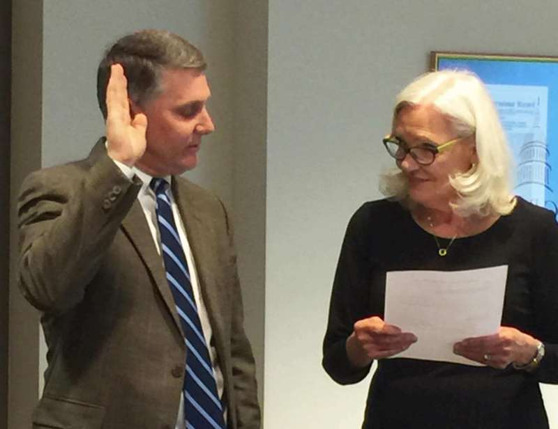 Henry Kayes, Jr. is given the oath of office by Dr. Marcia Brand, chair of the Shepherd University Board of Governors, during the board's February 24 meeting.