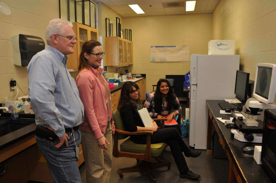 Taking training for Shepherd's Life Technologies EVOS FL Cell Imaging System fluorescence microscope are (l. to r.) Dr. Robert Warburton, professor of biochemistry; Dr. Carol Plautz, associate professor of biology; Amaris Jalil, a biology pre-med major from Charles Town; and Shruthi Sreekumar, a biology major from Morgantown.