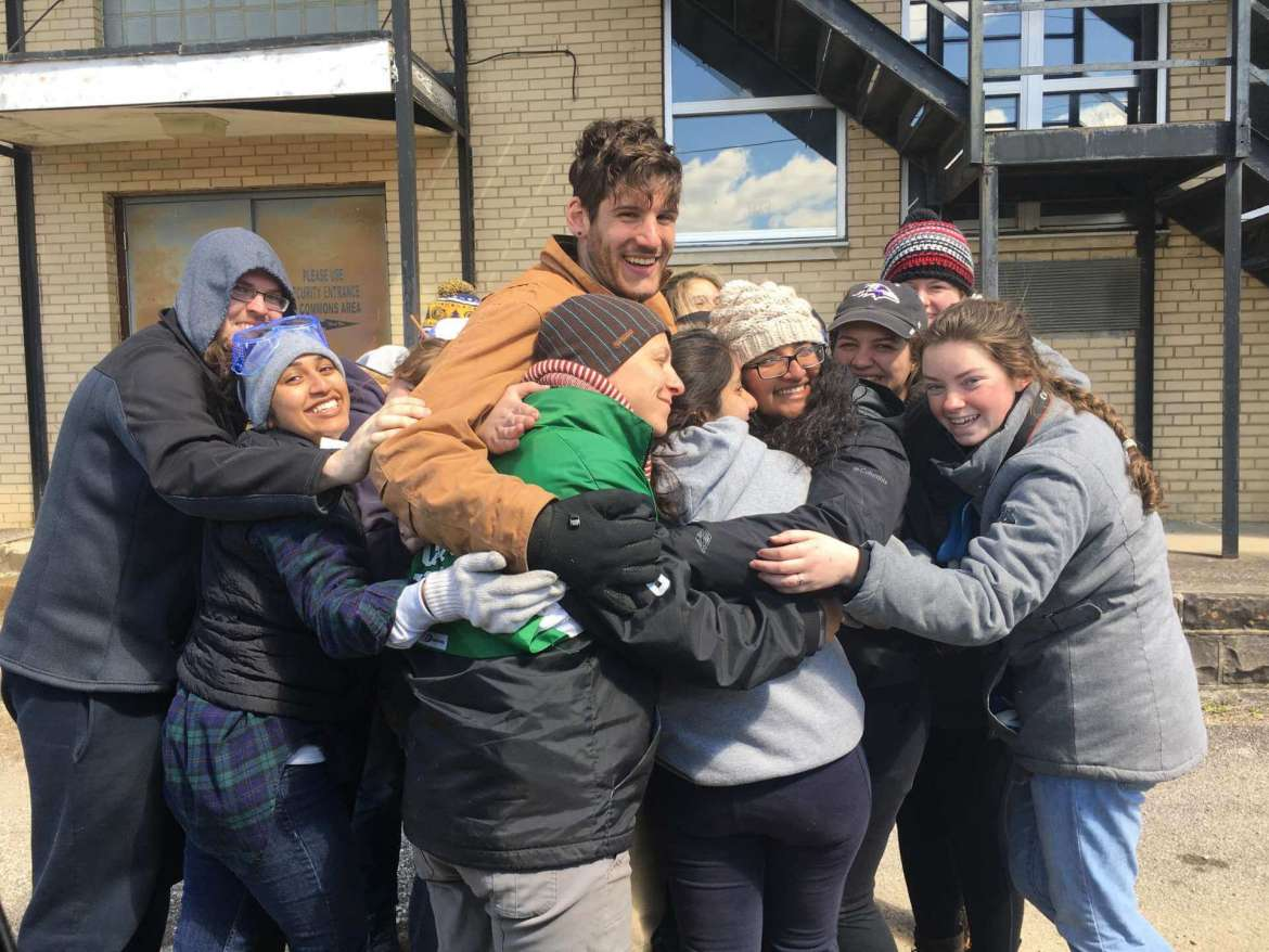 Group hug—Students from Shepherd University give Ian Noyes, director of the Big Laurel Learning Center near Kermit, a group hug. The students stayed at the learning center during Alternative Spring Break and Noyes enjoyed having them there so much that he volunteered to work with them at the Fort Gay School.