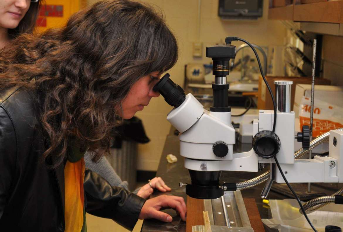 Amaris Jalil, a biology major from Charles Town, is one of several Shepherd science students who has benefited from the SOARS program. This past summer, Jalil helped Dr. Mark Lesser, assistant professor of biology, conduct research on how climate change affects trees in the Shenandoah National Park in Virginia. Here Jalil is looking at a tree core through a microscope in Lesser's lab at Shepherd.