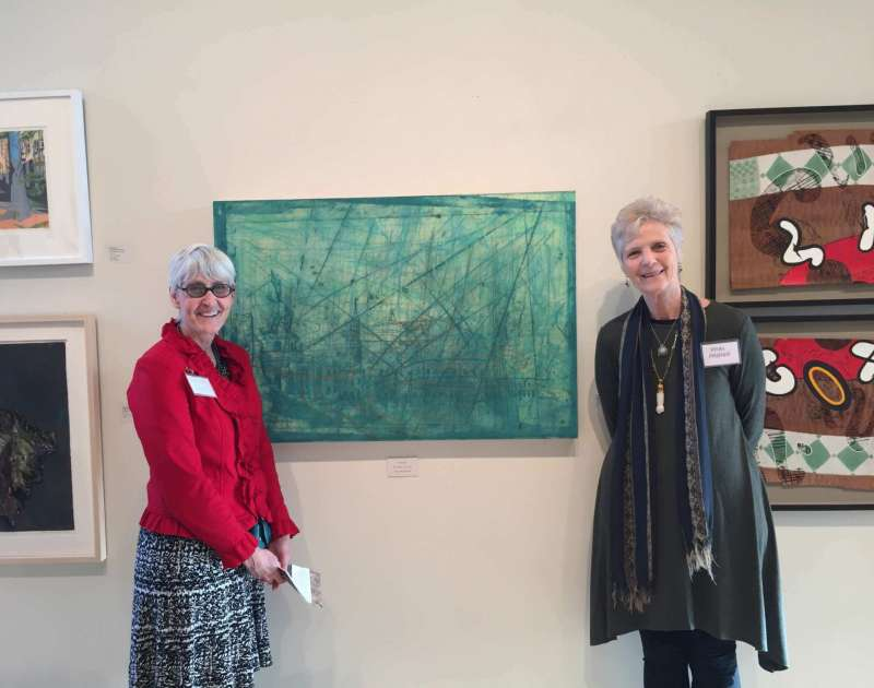 Rhonda Smith (l.), chair of the Department of Contemporary Art and Theater, stands in front of her print, which was awarded Best in Show, with Helen Frederick, juror for the show at the Black Rock Center for the Arts in Germantown, Maryland.