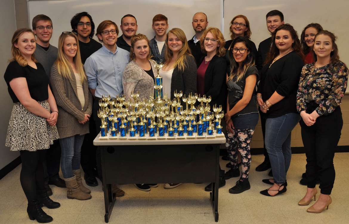 Shepherd University's Debate Team brought home many trophies from the tournaments they participated in this year. Pictured (front row, l. to r.) are Logan Kerr, a political science major from Inwood; Desiree Rose, a political science and economics major from Hedgesville; Will Wheatley, a political science major from Harpers Ferry; Katie Zakrzewski, a political science major from Berkeley Springs; Jenn Dickey, a business major from Mt. Airy, Maryland; Meredith Blady, a psychology major from Martinsburg; Karen Paiz, a political science an psychology major from Silver Spring, Maryland; Mikayla Duhaime, a political science major from Saratoga Springs, New York; and Madison Ronevich, a political science major from Inwood. Back row, Garrett Spiker, a political science major from Bunker Hill; David Bennett, an English major from Hedgesville; Lance Wines, a political science major from Winchester, Virginia; Casey Feezle, a political science major major from Augusta; Joseph Robbins, chair of the Department of Political Science and Debate Team advisor; Lauren Duckworth, a psychology major from Kingwood; Samuel Brown, a political science major from Charles Town; and Maggie Nevin, an English major from Martinsburg.