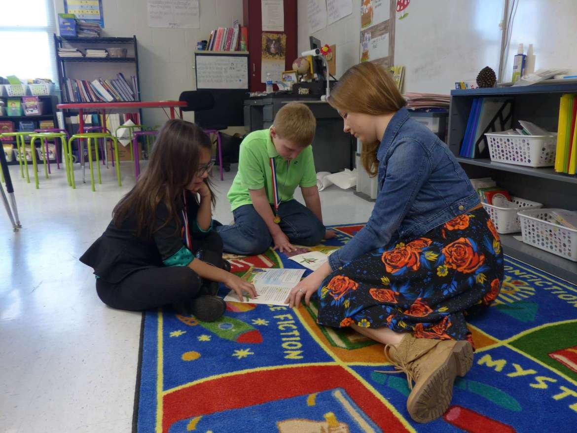Ashtyn Bittle, a recent Shepherd graduate and third grade teacher at Eagle School Intermediate in Martinsburg, works with two of her students, Isabella Silver and Grayson Mills. Bittle received a 2016-2017 National Network of State Teacher of the Year Teacher Candidate Fellowship.