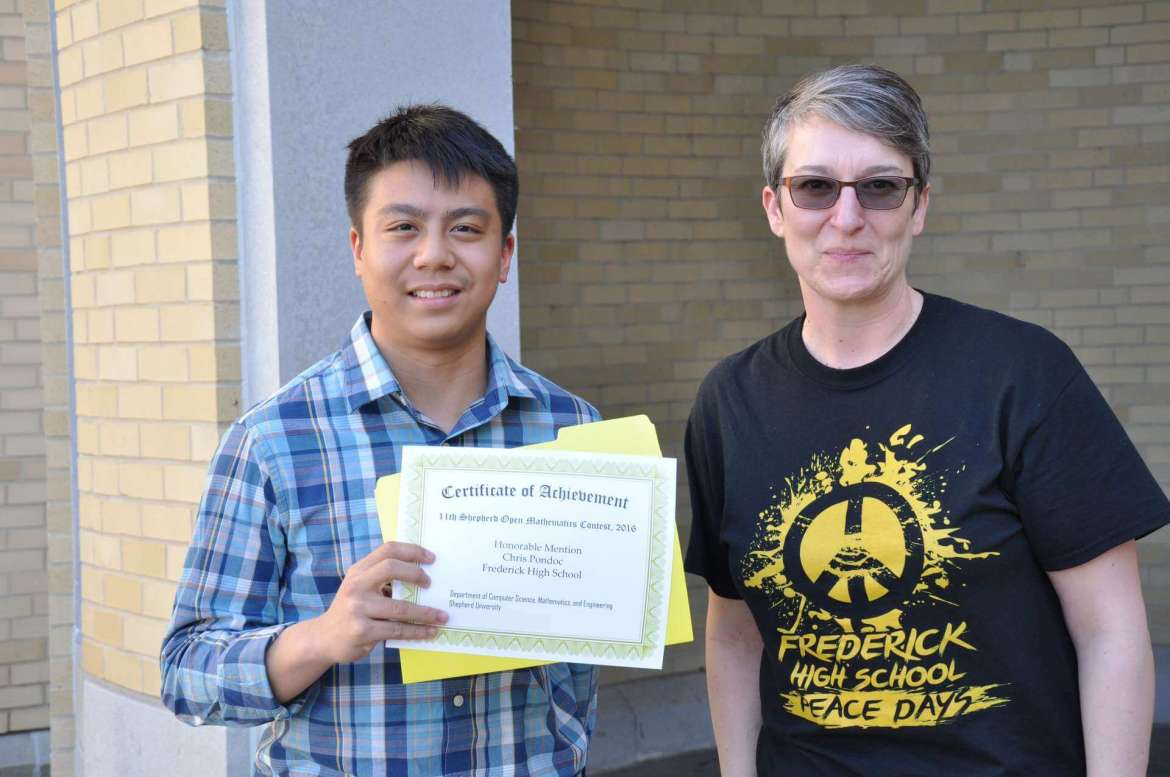 Chris Pondoc (l.) from Frederick (Maryland) High School received an honorable mention in the annual Shepherd University math competition. His math teacher,  Karine Ptak, was also recognized for her work in promoting the competition.