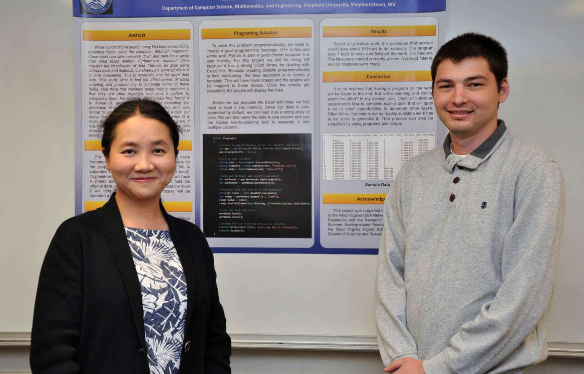 Dr. Qing Wang (l.), associate professor of mathematics, and Vasile Stadnitchii, a computer information sciences (CIS) major from Hagerstown, Maryland.