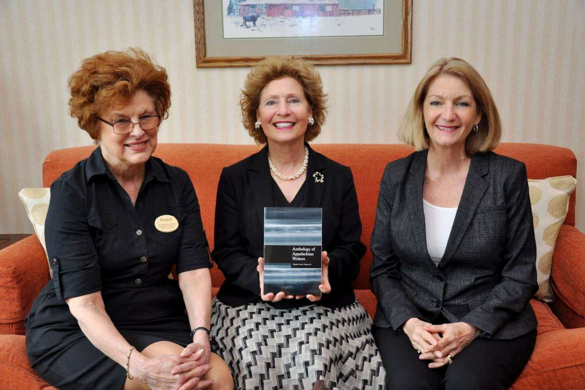"""The """"Anthology of Appalachian Writers: Charles Frazier Volume IX"""" published by Shepherd University is now available. Pictured with the book are (l-r) Dr. Sylvia Bailey Shurbutt, professor of English and senior managing editor of the anthology; Shepherd President Mary J.C. Hendrix; and Monica Lingenfelter, executive vice president of the Shepherd University Foundation."""