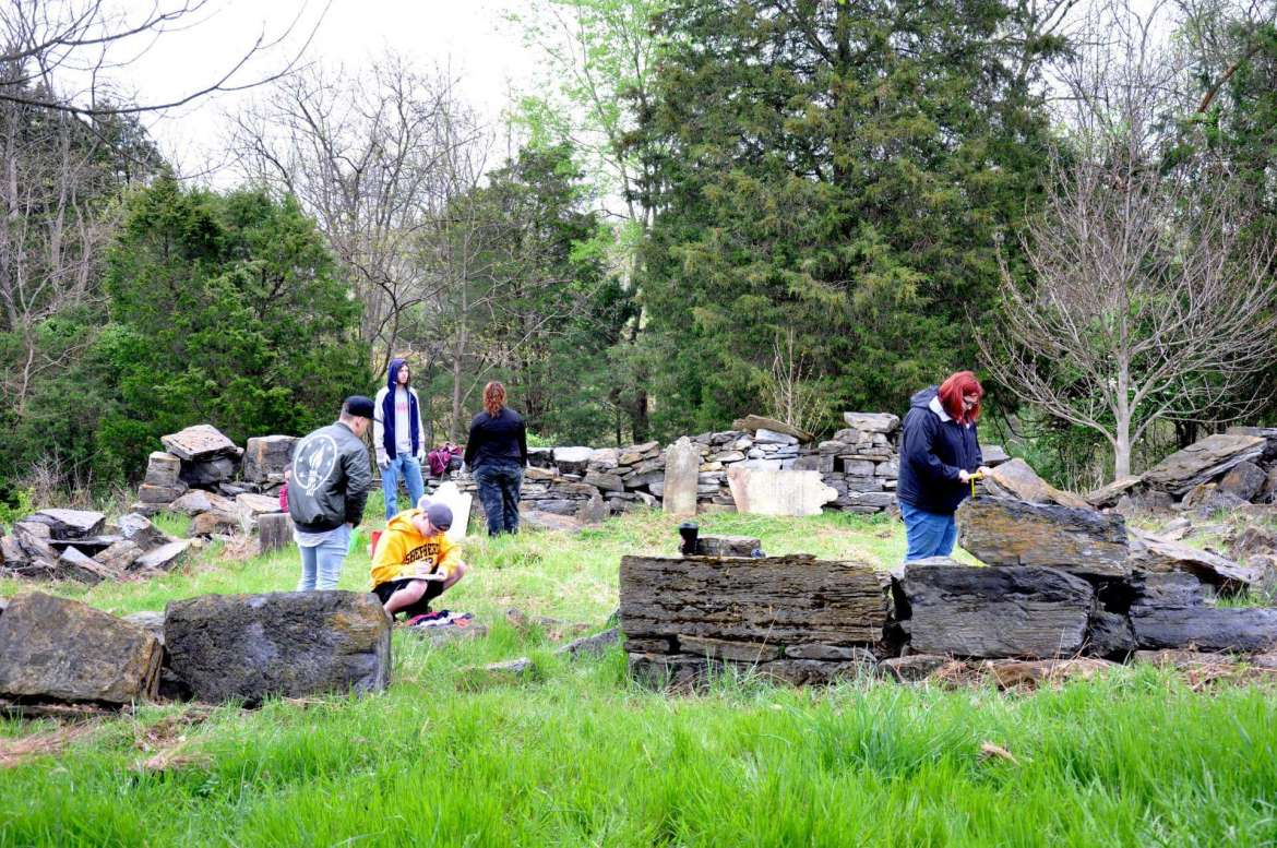 Students taking Dr. Keith Alexander's historic preservation class spent the spring semester documenting and cleaning an old Swearingen family cemetery at the U.S. Fish and Wildlife Service National Conservation Training Center.