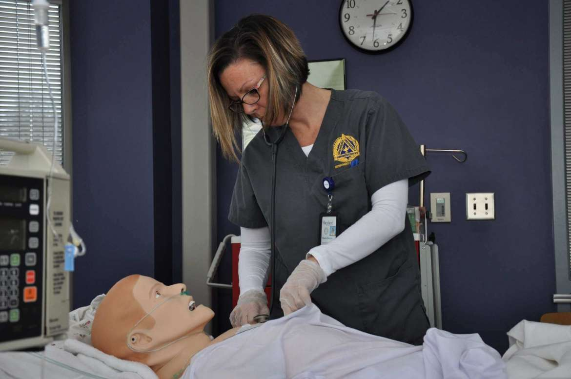 Nursing student Maria Donato, of Frederick, Maryland, practices her skills on Shepherd's SimMan 3G patient simulator, nicknamed George.