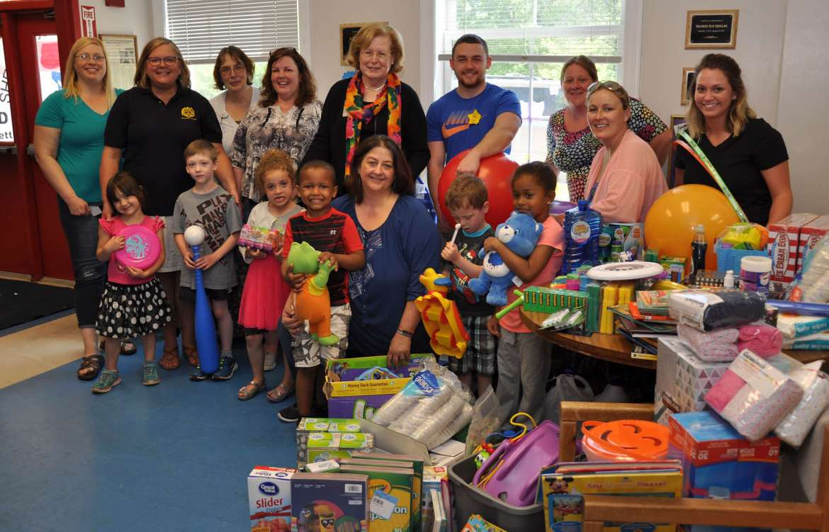Children at Shepherdstown Day Care will benefit from donations made by Shepherd University's Department of Nursing Education. Pictured (front row, l. to r.) Gabrielle Orr; John Danzy; Ava Bonacorda; Kaiden Hockman; Michelle Robinson, assistant day care director; Abel Considine; and Gracie Grantham, (back row) Melissa Holman, day care director; Dr. Barbara Mott, assistant professor of nursing education; Robin Hill, clinical skills and simulation lab coordinator/clinical lecturer; Stacey Spivey, nursing major, Charles Town; Dr. Sharon Mailey, chair, Department of Nursing Education; Austin McKinney, nursing major, Bunker Hill; Heather Connors, nursing major, Gerrardstown; Kelly Johnson, nursing major, Inwood; and Esstay Boggs, nursing major, Summit Point.