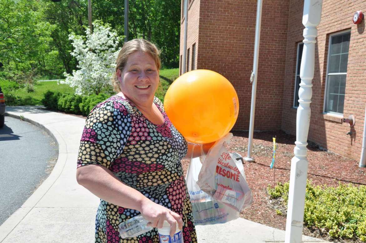 Shepherd University nursing major Heather Connors, Gerrardstown, carries items into the Shepherdstown Day Care center. After doing her clinical work at the center, Connors spearheaded a drive to collect donations of toys and other supplies.