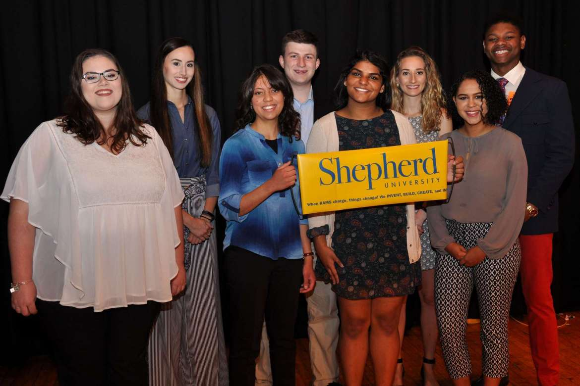 Shepherd University students who spoke at a special assembly for 10th graders at Martinsburg High School are front row, (l-r) Paige Palmer, Amaris Jalil, Sneha Reddy, and Brianna Hester. Back row, Tess Hyre, Samuel Brown, Kelsey Chaney, and Martinsburg High alumnus Da'Shawn Long.