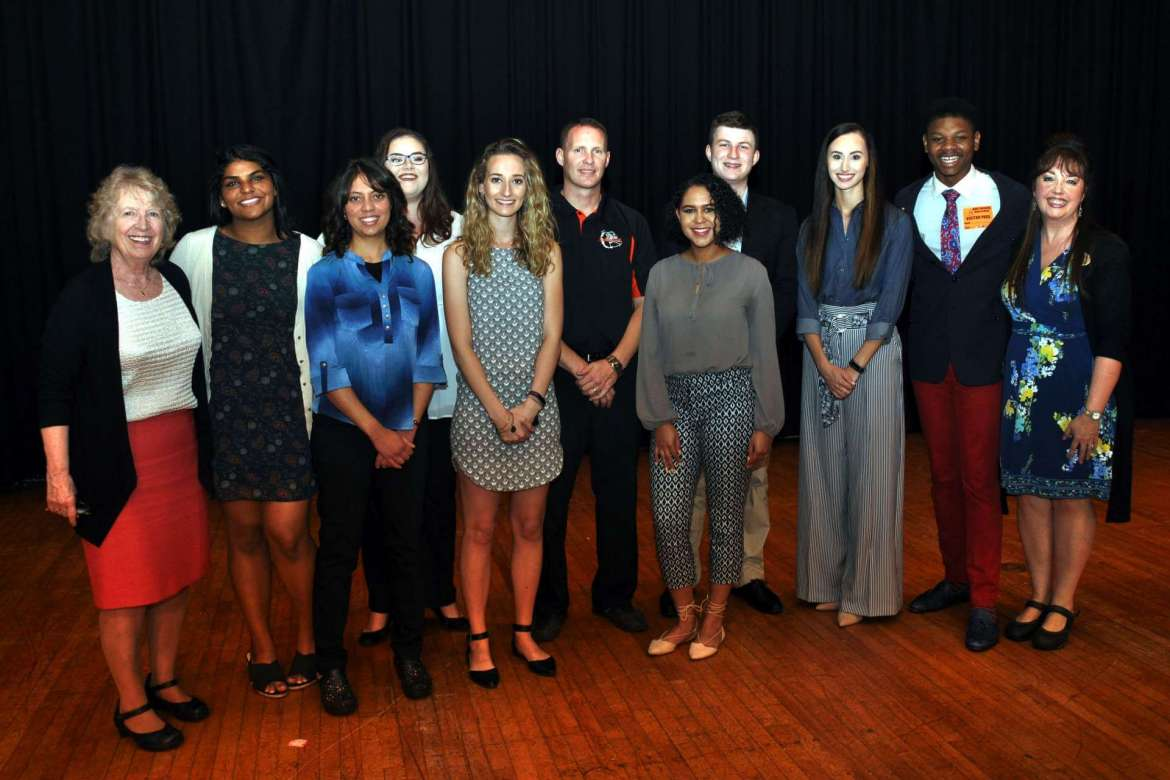 Pictured,  (l-r) are Shepherd's assistant provost for academic community outreach Dr. Virginia Hicks, Sneha Reddy, Amaris Jalil, Paige Palmer, Kelsey Chaney, Martinsburg High School principal Trent Sherman, Brianna Hester, Samuel Brown, Tess Hyre, Da'Shawn Long, and Barbara Kandalis, assistant to Hicks.