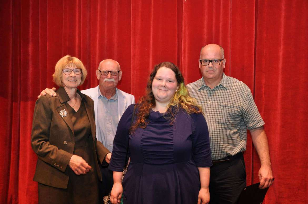 Pictured (l. to r.) are Susan Mentzer-Blair and Bill Blair, creators of the Mentzer Award for Inspirational Teaching; Allexandra Benedict, the student who nominated Nixon; and Dr. Timothy Nixon, associate professor of English, winner of the Mentzer Award.