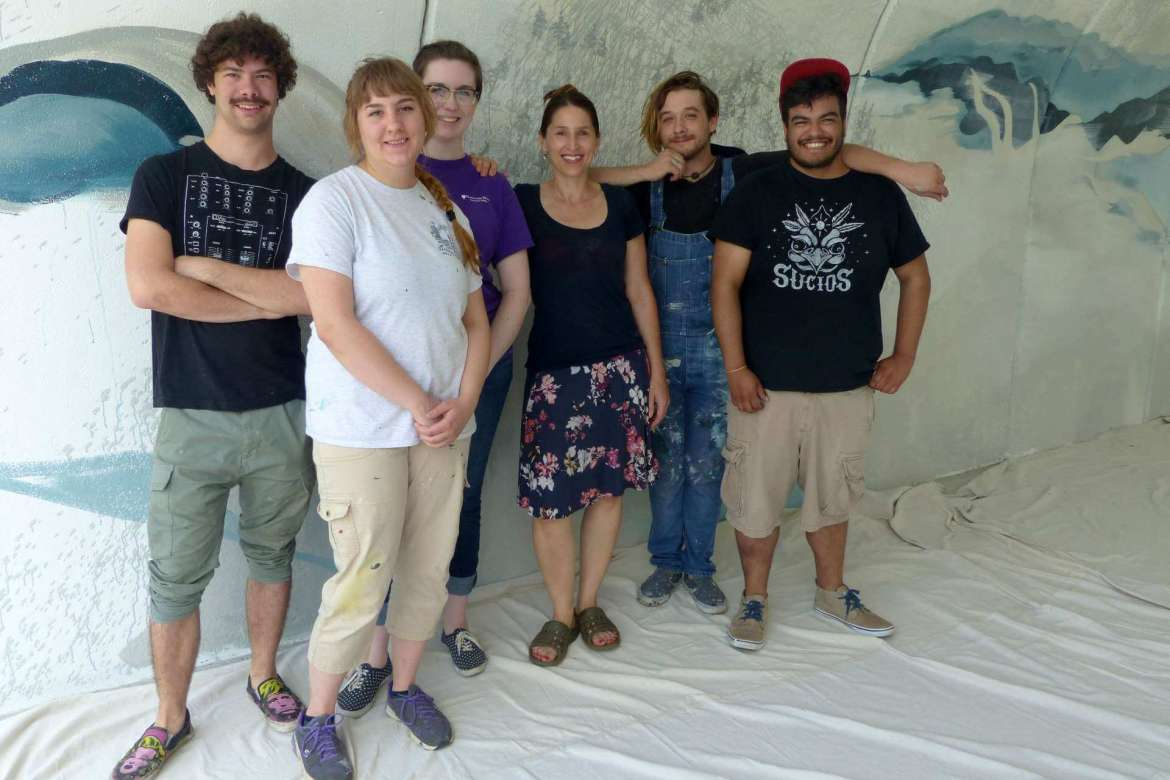 Students and alumni are working weekends to paint a mural on Shepherd's underpass. Pictured (l-r) are art majors Kaleb Aurand, Silver Spring, Maryland; Rachael Dutko and Katelyn Wyant, both of Martinsburg; Sonya Evanisko, professor of art; Josh Hawkins, alumnus and mural designer; and art major Fernando Velez, Martinsburg, mural designer.