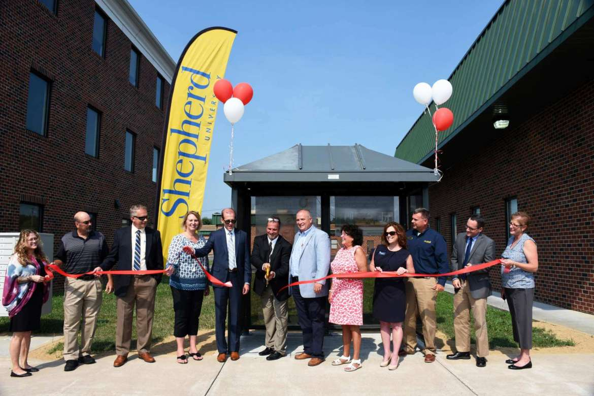Helping cut the ribbon for the new EPTA shelter are (l. to r.) Kim Ford, EPTA Board of Directors; Mike Ferrari, EPTA Board of Directors; Dan Dulyea, Berkeley County Council member; Elaine Bartoldson, EPTA deputy director; Dr. Scott Beard, Shepherd acting provost; Doug Pixler, EPTA director; Kevin Knowles, Martinsburg City Council member; Harriet Weakley Johnson, Martinsburg City Council member; Kristina Arntz, Aikens Group director of hotel sales and marketing; Jim Klein, Shepherd Martinsburg Center director; Matt Mullenax, Hagerstown/Eastern Panhandle Metropolitan Planning Organization executive director; and Lori Taylor, Berkeley County Development Authority business programs manager.