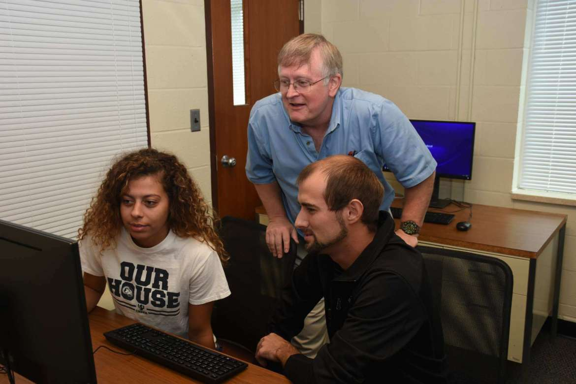 Dr. Larry Daily, chair of Shepherd's Department of Psychology, works with two students in the new psychology laboratory.