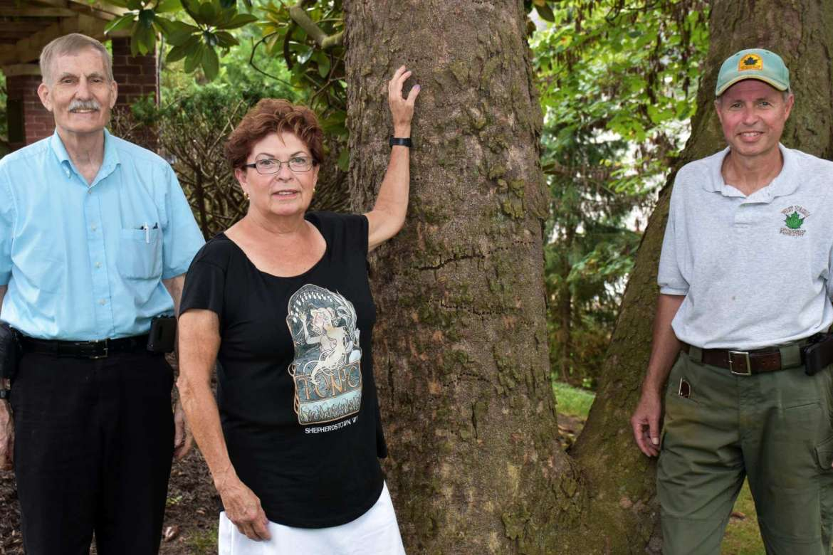 Pictured (l. to r.) are Delegate John Overington, sponsor of the Eastern Panhandle largest tree contest; Elisabeth Staro, a volunteer who heads the garden restoration program at Popodicon; and Herb Peddicord, Chesapeake Bay watershed forester for the West Virginia Division of Forestry.