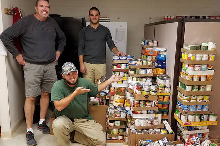 Members of Shepherd University's facilities department delivered 2,840 pounds of food collected by Shepherd students during Homecoming week to Jefferson County Community Ministries. Pictured (from l.) are John Cloyd, JCCM Staffer; Dryan Cole, landscape worker at Shepherd University; and Robert Hatcher, landscape worker at Shepherd University.
