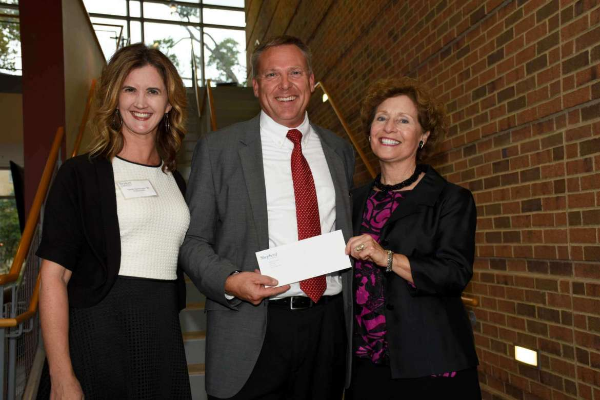 The Shepherd University Alumni Association recently presented a check for new band uniforms to Dr. Scott Hippensteel, associate professor of music and director of bands. Pictured (l. to r.) are Sandy Sponaugle, Alumni Association president; Hippensteel; and Dr. Mary J.C. Hendrix, Shepherd president.