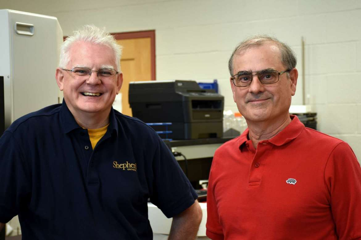 Pictured (l. To r.) Dr. Robert Warburton, acting dean, College of Natural Sciences and Mathematics, and Dr. Dan DiLella, chair, Department of Chemistry.