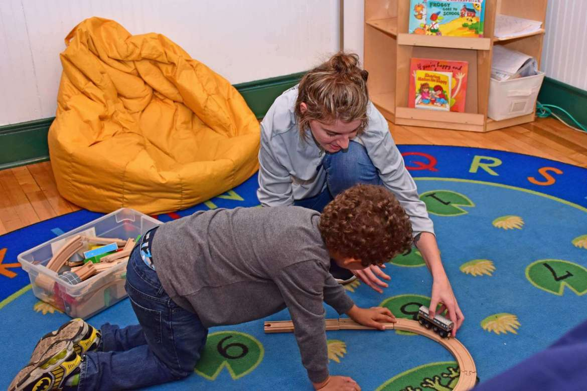 Andi Zellman, a Regents Bachelor of Arts student from Martinsburg, works with a child in the Baby & Me room at Burke Street Elementary School.