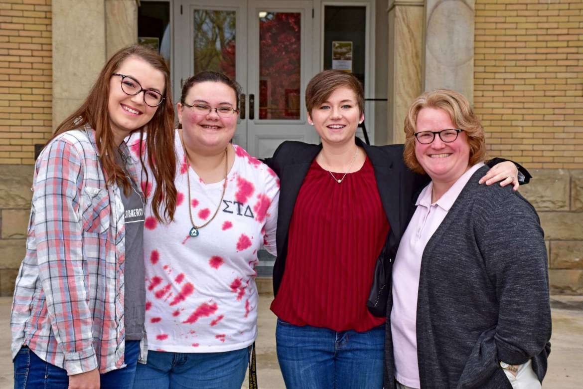 Organizers of a regional undergraduate literature conference held at Shepherd University November 4 included (l. to r.) Brianna Maguire, Paw Paw; Gabrielle Hersey, Delray; Kylie Krummel, Fishers, Indiana; and Dr. Heidi Hanranhan, associate professor of English and Alpha Gamma Kappa advisor.