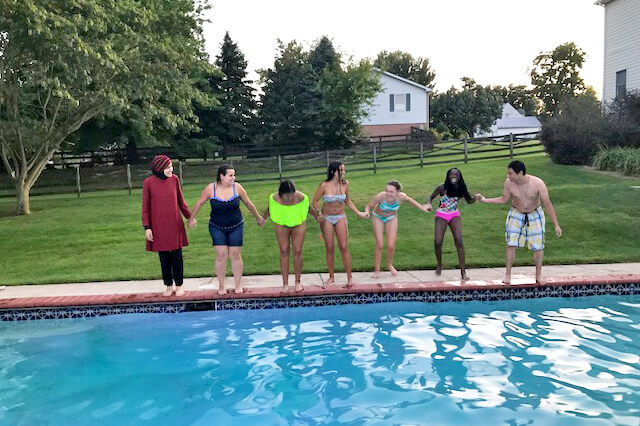 International students who are attending Shepherd University enjoy a day at the pool of a local home.