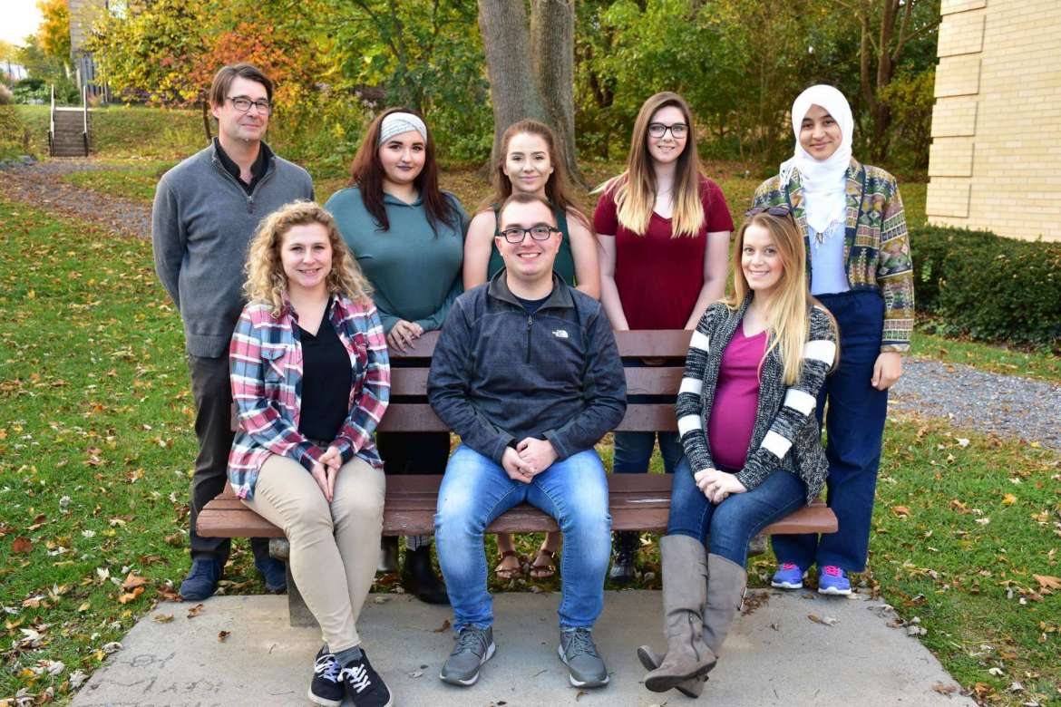 Members of Shepherd University's Model UN team are (seated, l. to r.) Katie Zakrzewski, political science, Berkeley Springs; Devin Spinks, global studies, Summersville; Desiree Rose, political science and economics, Hedgesville; (standing) Dr. Aart Holtslag, associate professor of political science and Model UN advisor; Mikayla Duhaime, political science, Saratoga Springs, New York; Madison Ronevich, political science, Inwood; Miranda Jones, global studies, Huntingtown, Maryland; and Imen Bouhestine, global studies, Tunisia. Not pictured are Rebecca Kamp, global studies, Martinsburg; and Jackson Muse, political science, Fairfax, Virginia.
