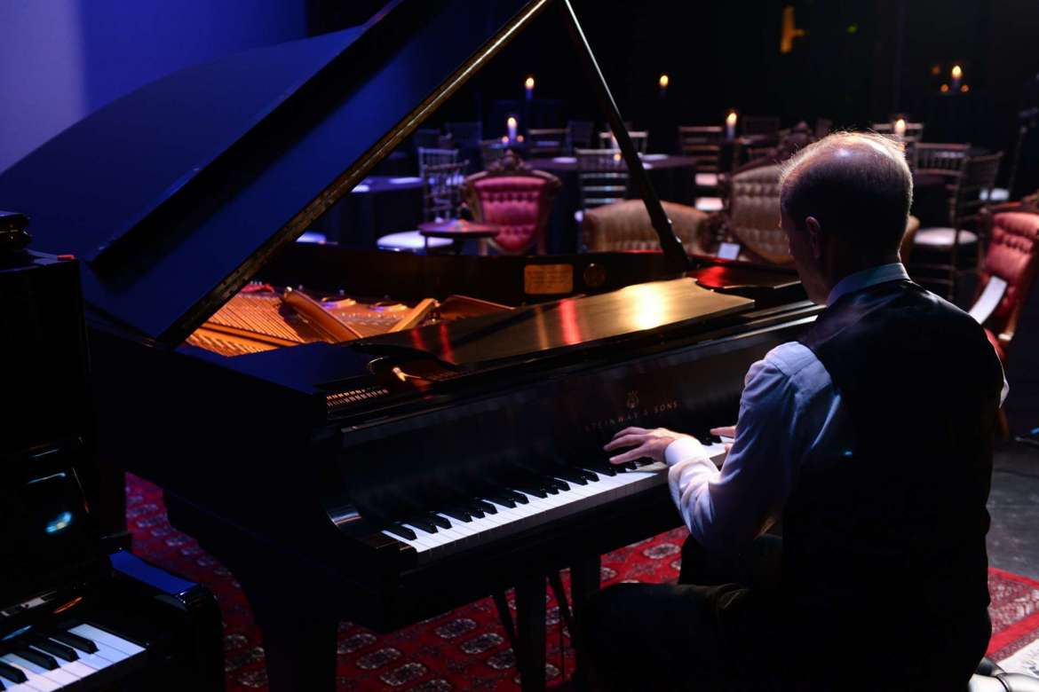 Dr. Scott Beard, professor of music and acting provost, performed on the Steinway B grand piano for the guests.