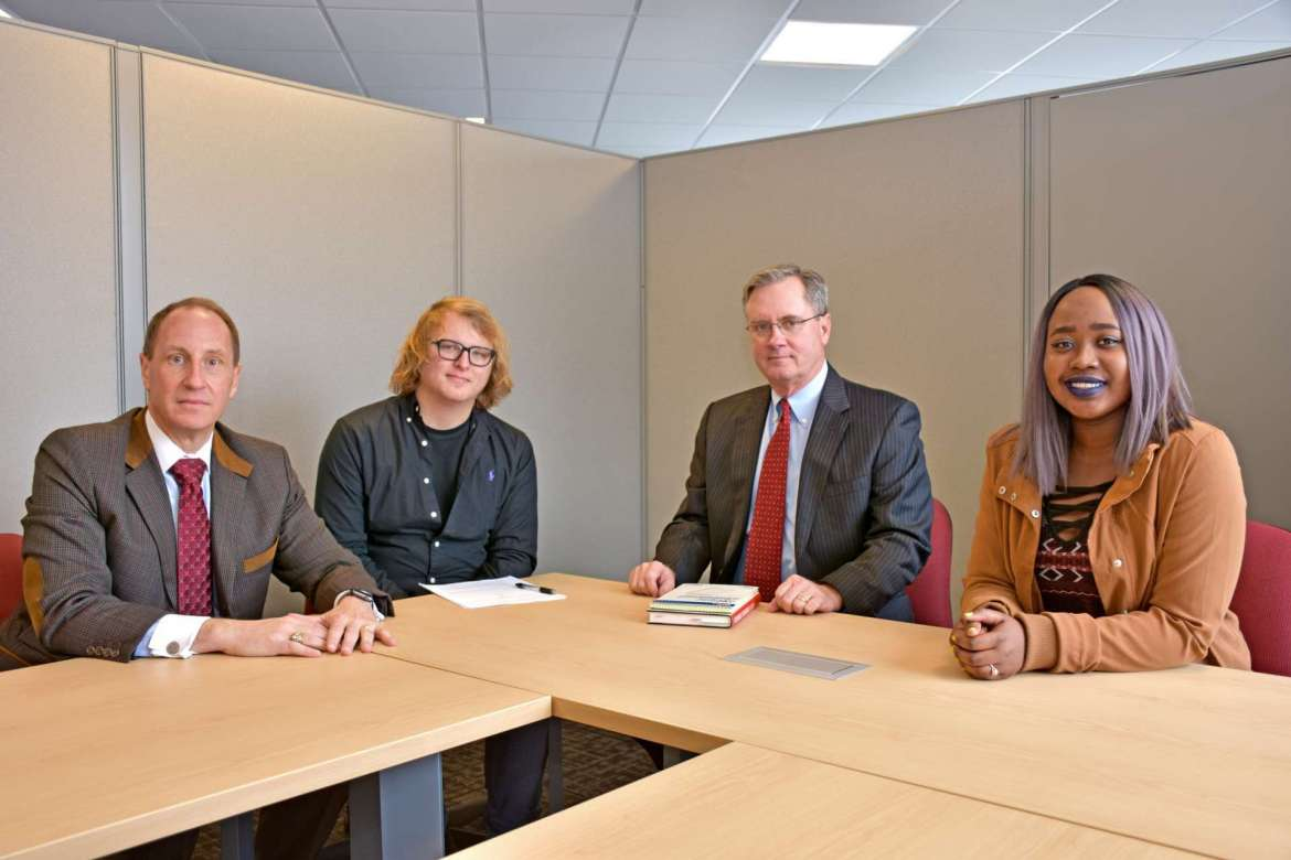 """The Potomac Applied Business Company (PABC) at Shepherd University has hired its first three student interns who will will assist in the migration of three company websites from older, inefficient web platforms to more modern and flexible platforms that are optimized for the mobile environment. Pictured (l.-r.) are Frank Genco, PABC CEO; Hunter Koppenhaver, an art major from Shenandoah Junction; John P. """"Pat"""" Philbin, Ph.D., president and CEO of Old Dominion Strategies; and Yani Meda, a communication and new media and art major from Charles Town. Not pictured is student intern Christina Rossomondo, an art major from Woodbine, Maryland."""