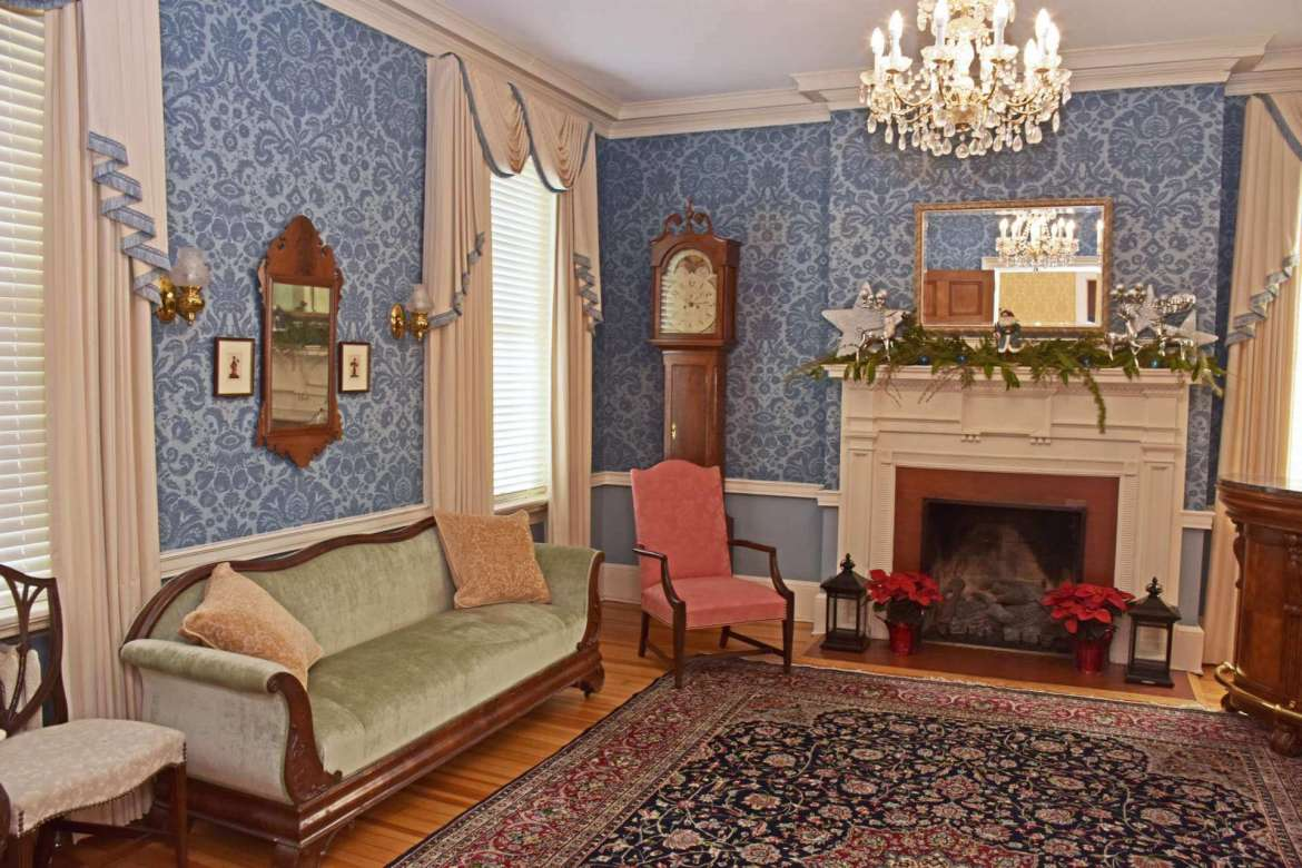 """The Empire style sofa is one of several pieces of furniture donated by Julia """"Happy"""" Potts Grehan to Popodicon."""