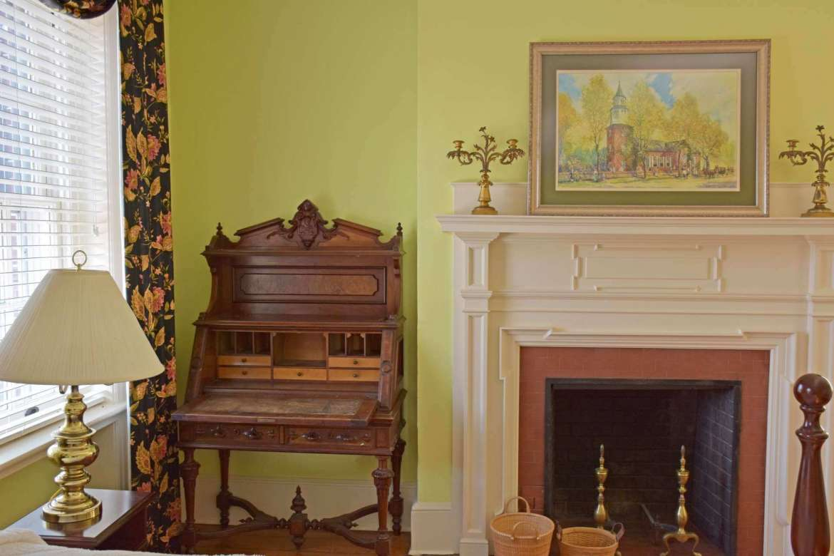 The desk to the left of the fireplace was used by Henry W. Potts, who built Popodicon.